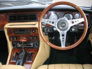 "A 15"" Mk9 steering wheel with drilled alloy spokes and plastic horn push, mounted on a Series 3 XJ"